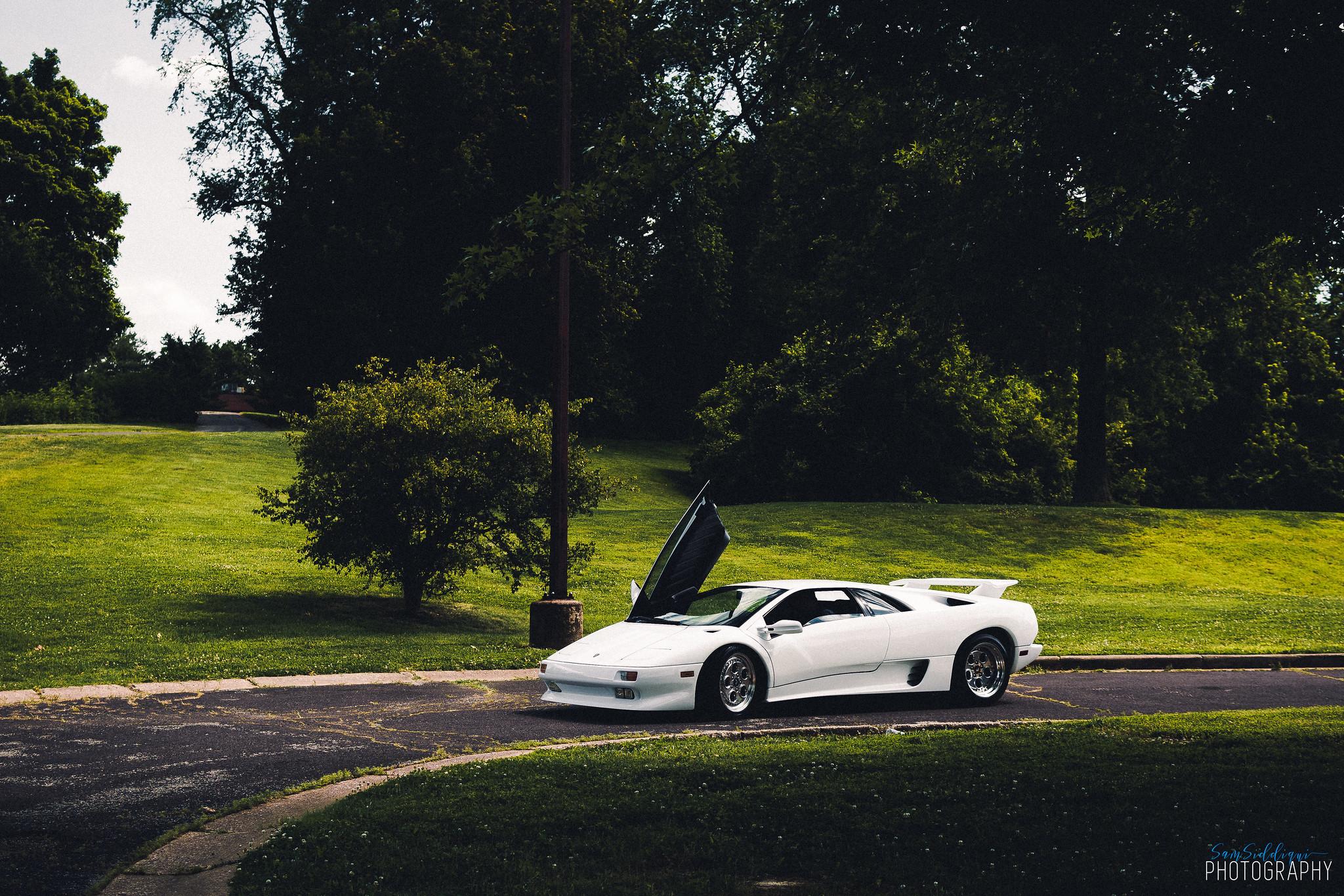 1991 White Lamborghini Diablo on road