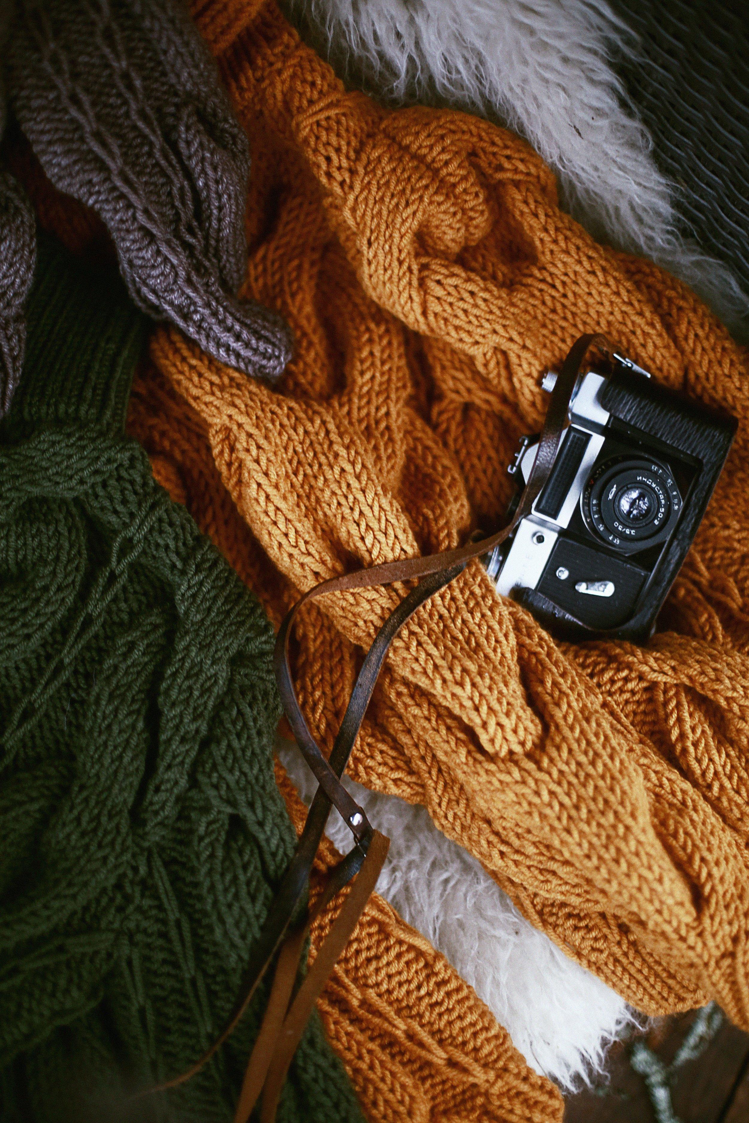 camera-knit-knitwear-879814.jpg