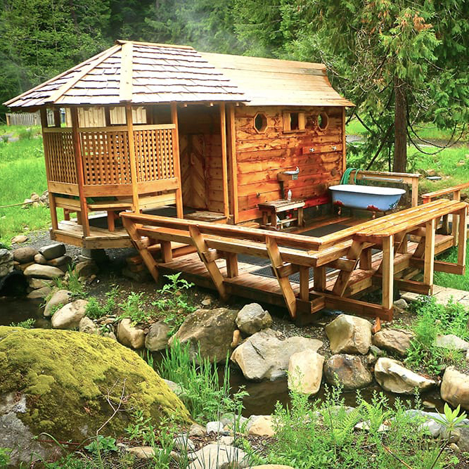 Sauna - The Steam Sauna is located in a cedar cabin with a slotted floor that welcomes steam from the waters below. On the sauna deck you'll find a tub filled with cold water from the river.