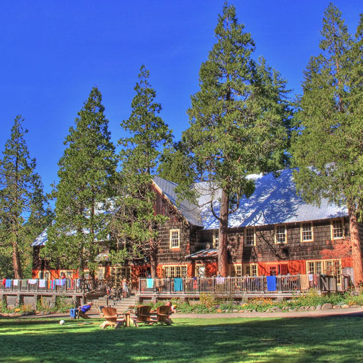 LODGE - Built around 1930, the historic lodge is the center of activity at Breitenbush. Inside the lodge is the dining room where you'll be enjoying organic buffet style meals, a large event space, and two libraries for relaxing and reading.