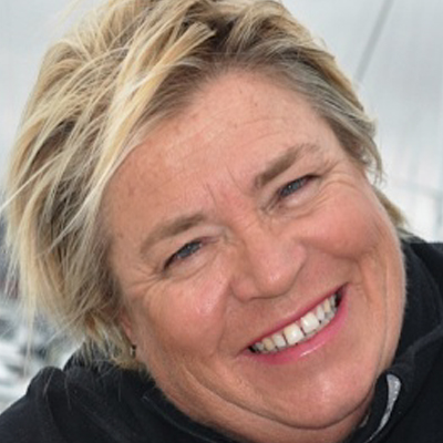 Penny Whiting MBE - SV Endless Summer | New ZealandPenny started sailing with her father and has been sailing all her life. She helped her father build several boats before the age 15 when she crewed with him in the Whangarei to Noumea yacht race. Penny started the Penny Whiting Sailing School in 1966 and sailed to the Pacific and then Alaska before building the boat she has today, 'Endless Summer'. Penny was married to Doc Williams and had two children Carl and Erin. For 51 years Penny has taught approximately 33,000 students from all around the world and has been awarded the M.B.E. for her services to New Zealand. Today Penny is enjoying teaching her five grand children about the sea and boats.