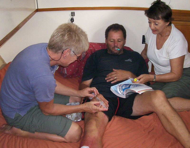 Cathy administering IV antibiotics. Streaks of red are seen from the infected cut.