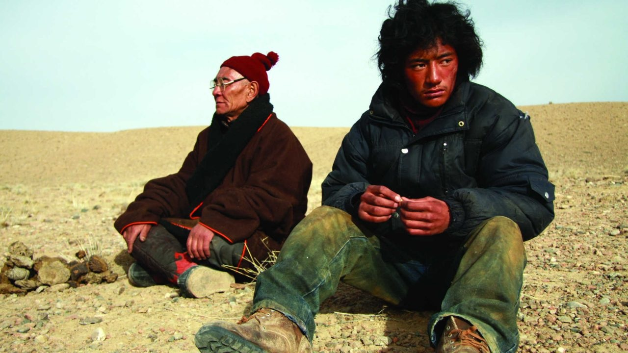 The Sun Beaten Path Sonthar Gyal   2011   Tibet   89'   Drama   Tibetan with English Subtitles Screenplay: Sonthar Gyal Actors: Yeshe Lhadruk, Lo Kyi, Kalzang Rinchen    Trailer    Nima, a stableman who has suffered a great misfortune, is on a pilgrimage. Is the young man trying to throw himself off the cliff or has he dozed off on a motorcycle? Loneliness and desolation characterize the film. Long shots show barren landscapes, in the midst of which endlessly long roads stretch along. Tibetan highways. Encrypted and mysterious. The film was shown at the International Film Festival in Locarno and won the Dragon & Tigers Award at the Vancouver International Film Festival 2011. Previously known as the cameraman for The Search, Sonthar Gyal makes his debut as a director with this film.