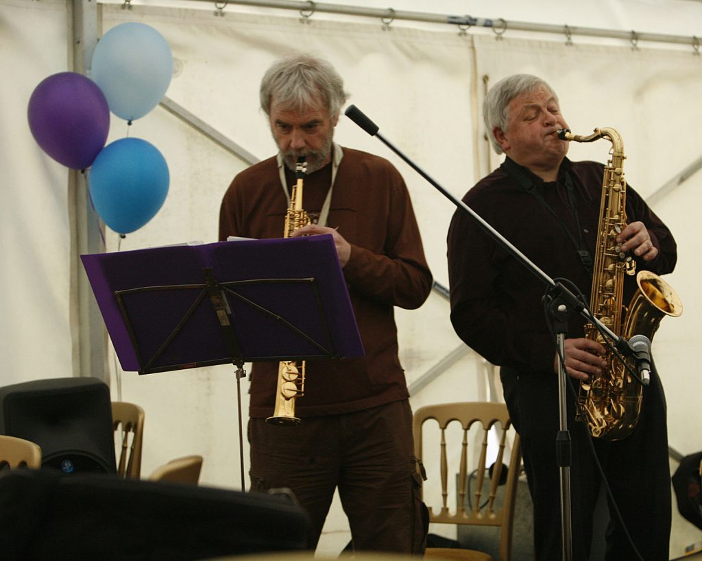 Pete Newman on alto saxophone Martin Kemp (right) on tenor saxophone