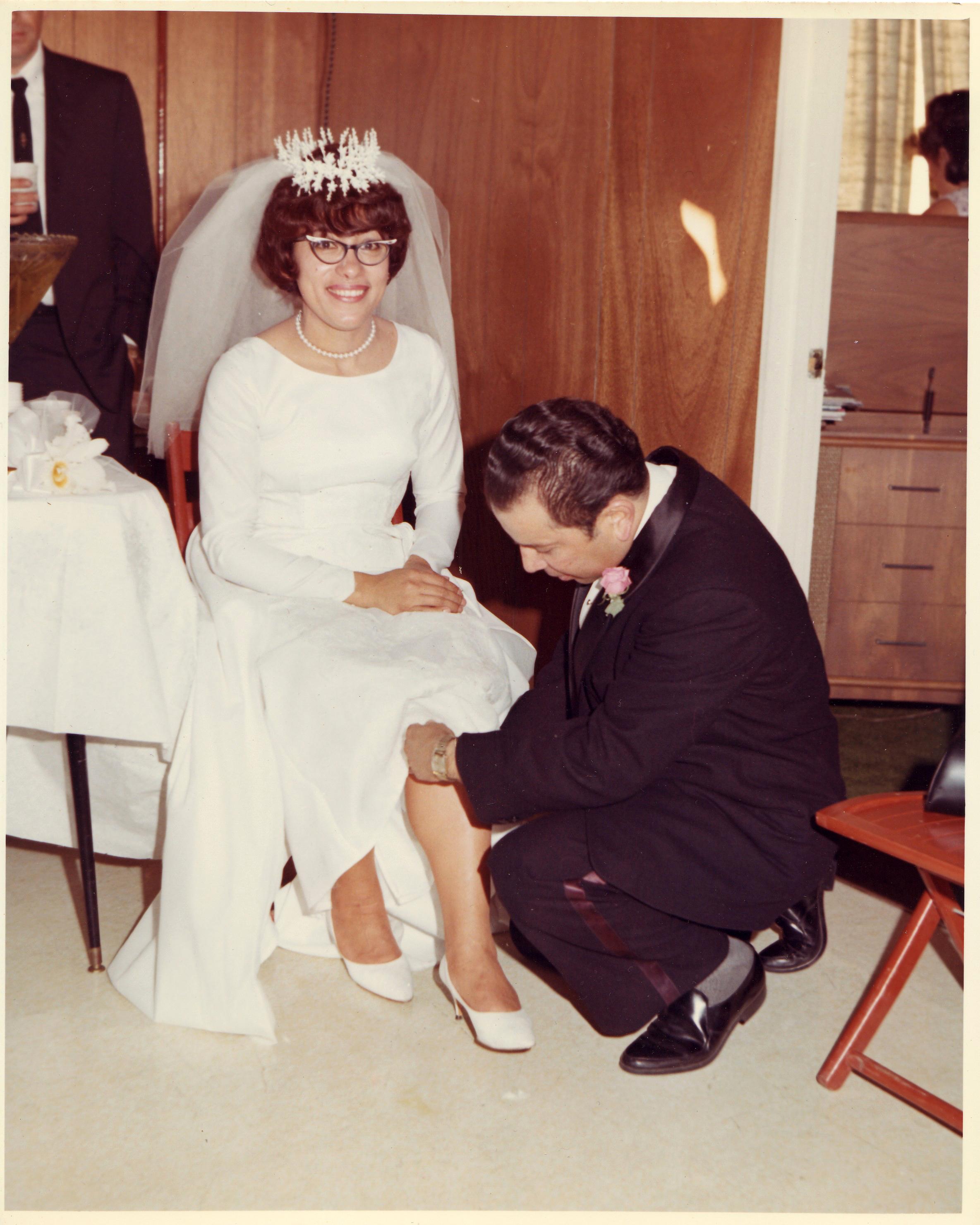 1966-RC-Getting the Garter, Raul and Elsa's wedding.jpg