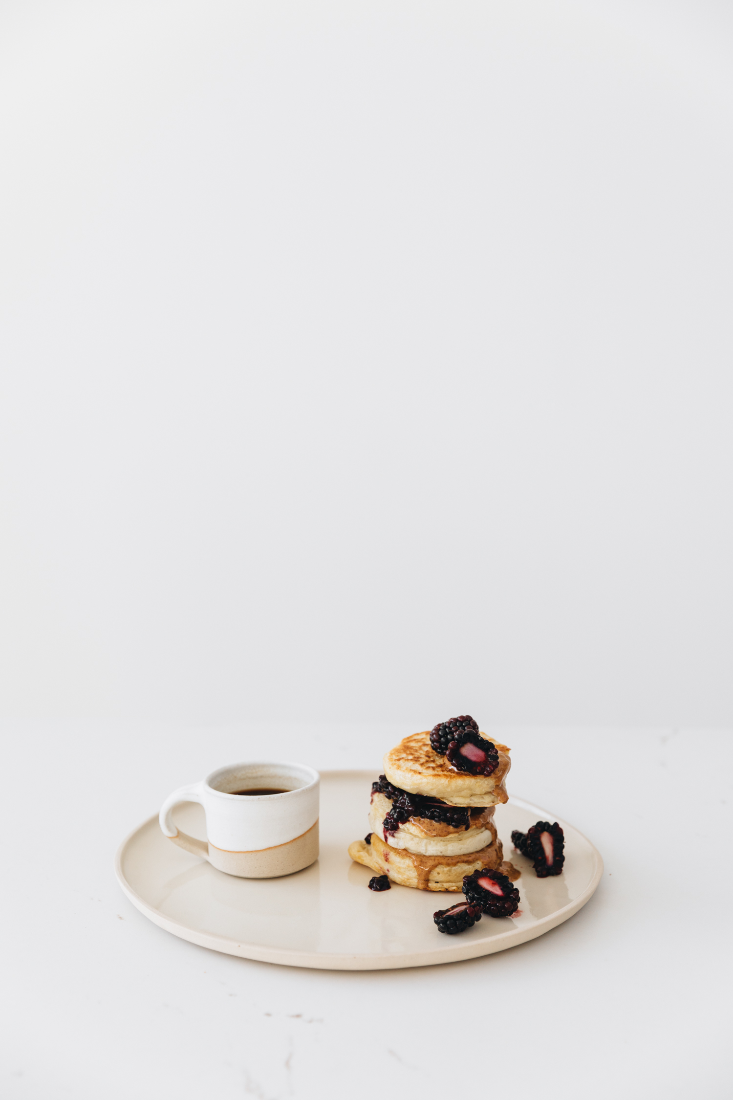 Crumpet with nut butter and blackberries