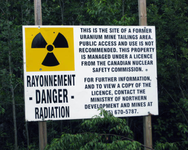 MNDM radiation warning on uranium mine tailings area.
