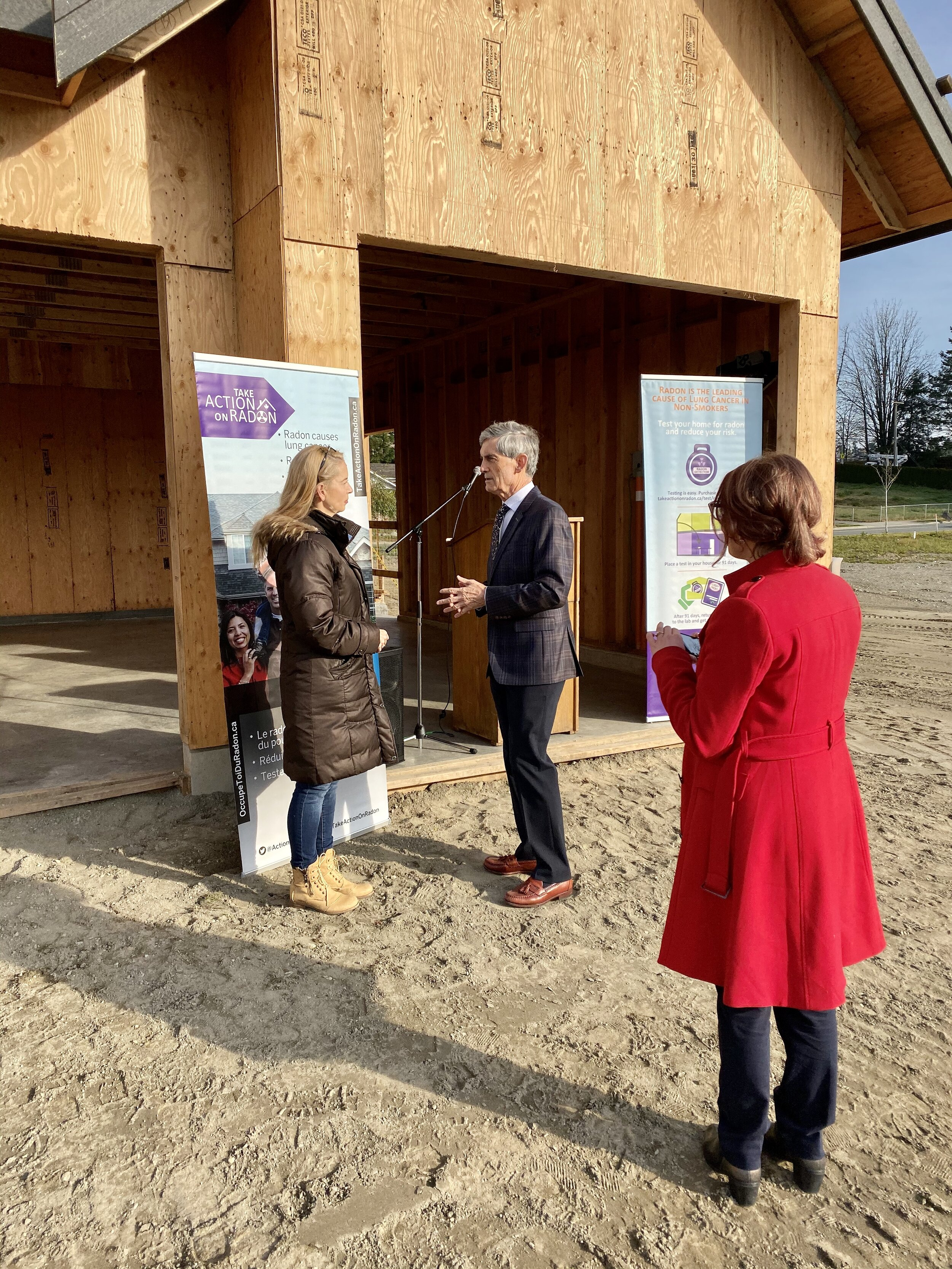 Dr. Anne-Marie Nicol (CAREX/SFU) talking with Simon Gibson, MLA for Abbotsford and Mission Districts.