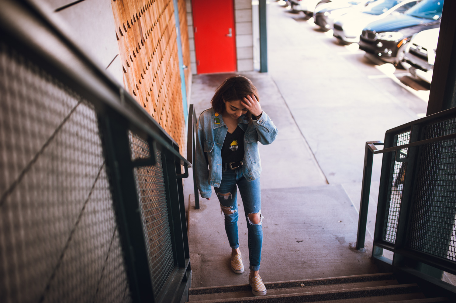 woman in jean jacket and Boomtown shirt