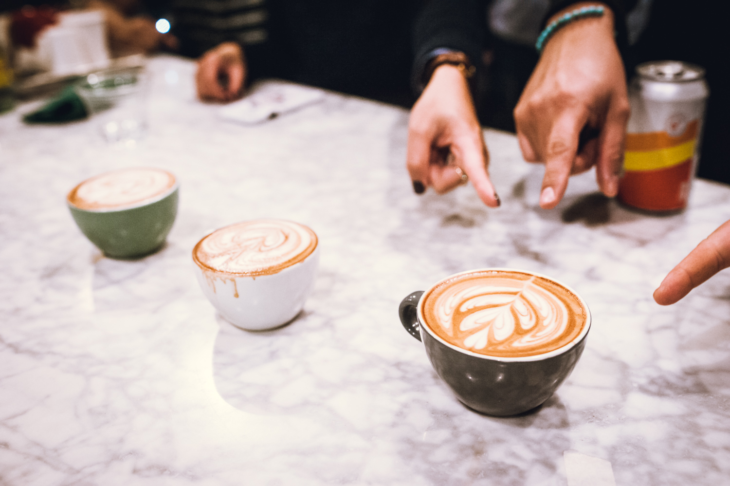 On the count of three, the judges point at their favorite pour