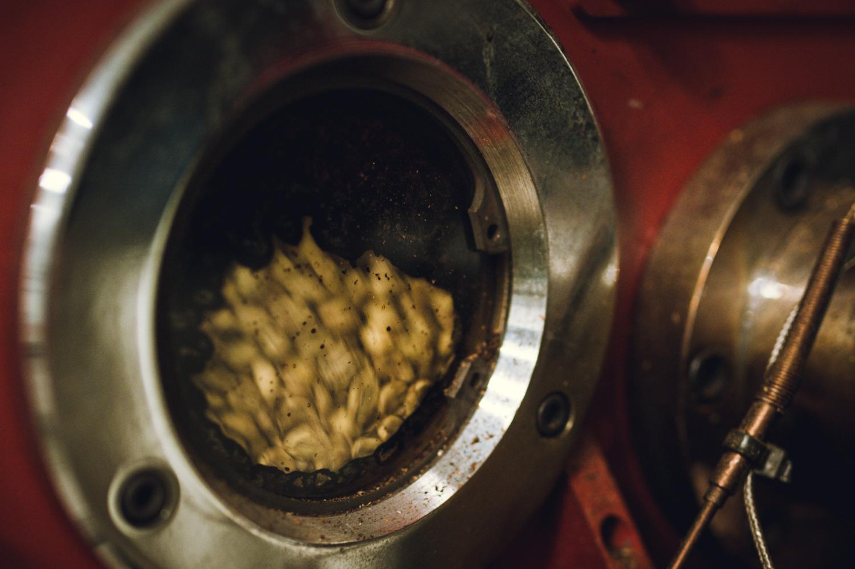 A closeup of the roaster's sightglass