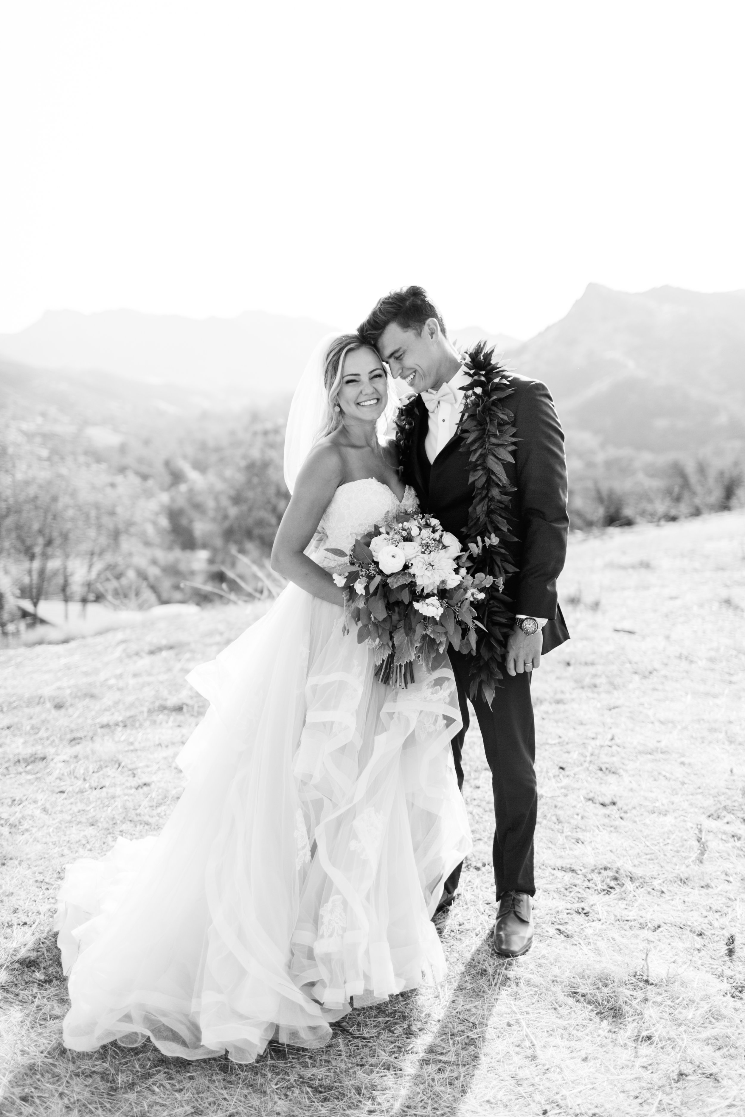 """Jess & Ben - """"Our wedding day was 95 degrees, my hair was stuck to my neck, yet she made my husband and I look as if we just stepped out of a fairytale. Her spunk and energy brought smiles out of everyone from our baby cousins to our grandma and grandpas. Now that all is said and done, our family has her photos to cherish forever; both moments my husband and I witnessed at our wedding, and moments that were sheer joy to first see while looking through our finished album. Booking Sara was the most confident choice I made in wedding planning, and she was hands down our best vendor! Thank you, Sara! We were honored to have you be a part of the most important day of our lives."""