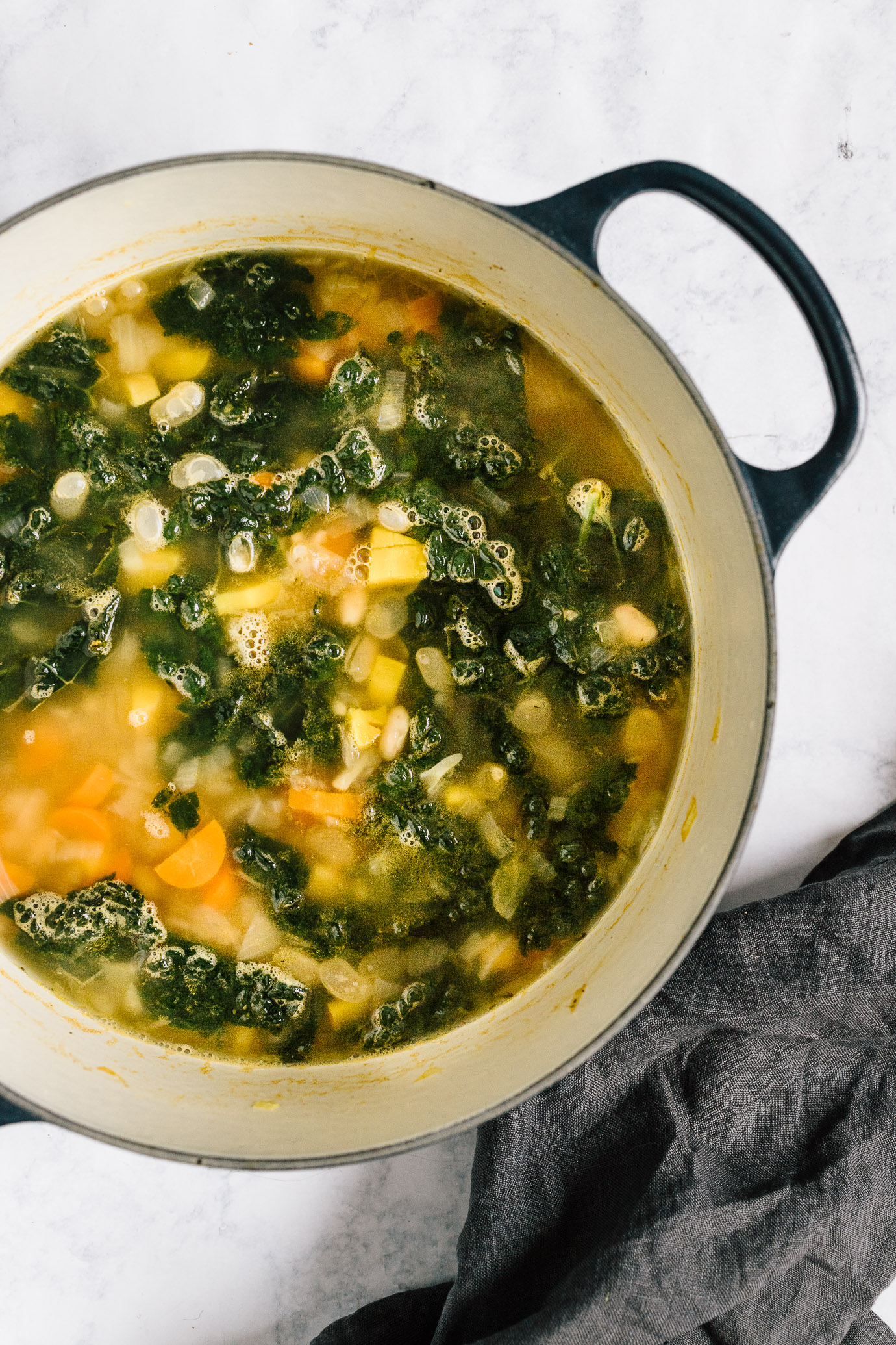 kale and white bean soup with lemon in Le Cruset