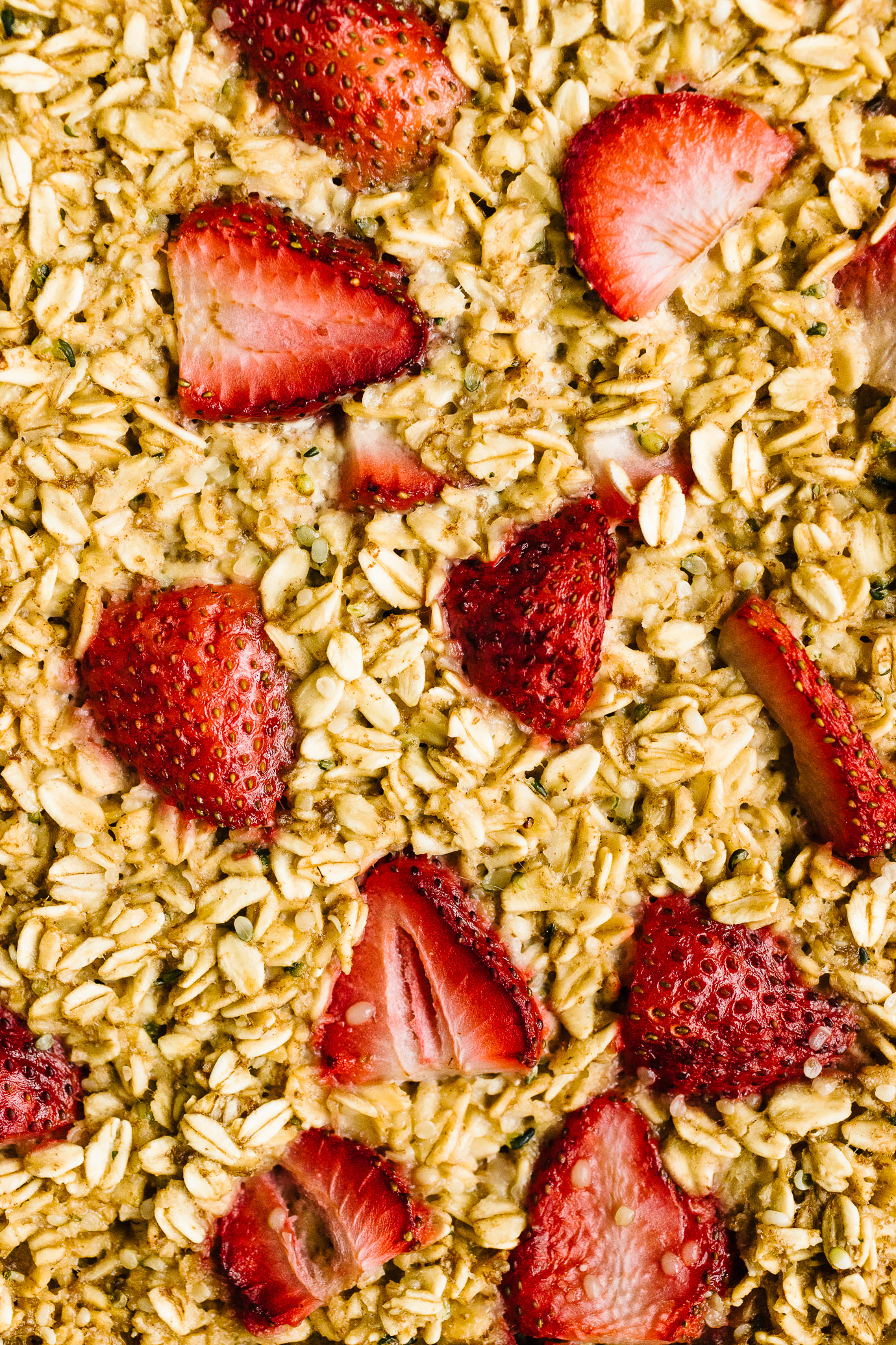 close up of baked oatmeal studded with strawberries