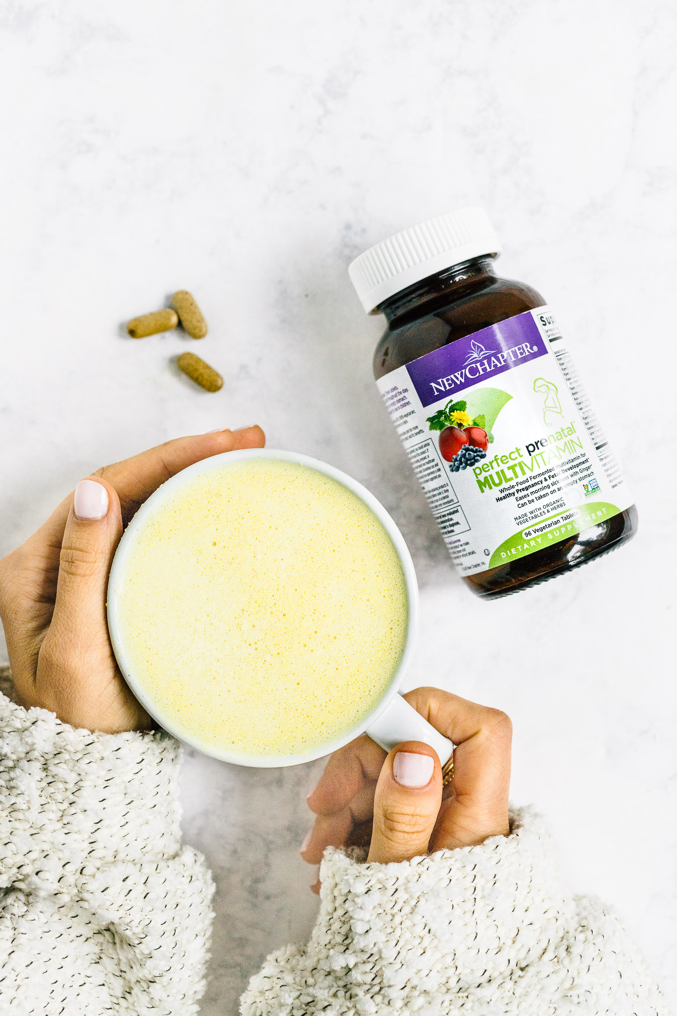 New Chapter's Perfect Prenatal Multivitamin bottle and golden milk latte