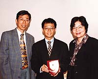 hMr Lam Kin-chung (middle), sponsor of the Librarians' Roundtable and Specialized Workshop on Institutional Research in Open and Distance Learning, with OUHK Librarian Mrs Mok Wong Wai-man (right) and Mr Alex Wong, Head of Public Affairs.