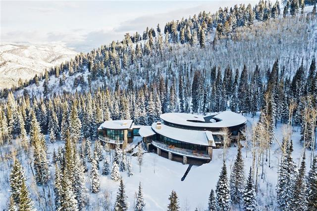 "217 White Pine Canyon Road - MLS: 11807994 | List Price: $14,000,0006 Bedrooms | 9 Bathrooms | 12,303 SQ FTThe estate sits on a 4.5-acre lot and is skiable to nation's largest ski resort, directly from your personal ski lounge. Enjoy mature evergreens and southern ski run views from your 80' deck or the private master suite, located on its own wing. There is a 12-person saltwater infinity hot tub controlled remotely, whether you're landing at the airport or skiing in the mountains, it will be ready for you overlooking the 100' long water feature. Other luxuries include a true ""chefs"" kitchen, custom home theatre, private gym, wet bar with wine room attached, and a spacious family room."