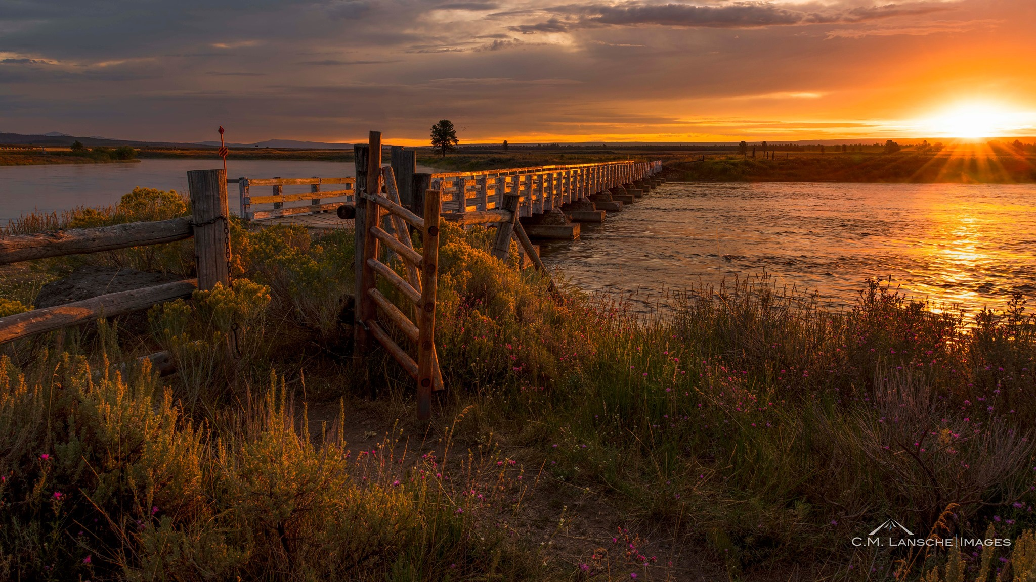 Osborne Sunrise. How many ranchers, fishermen, and passersby have crossed the Henry's Fork via the historic Osborne Bridge? It's a question that I ponder each time I walk through this gate. Island Park, Idaho. August 24, 2019.