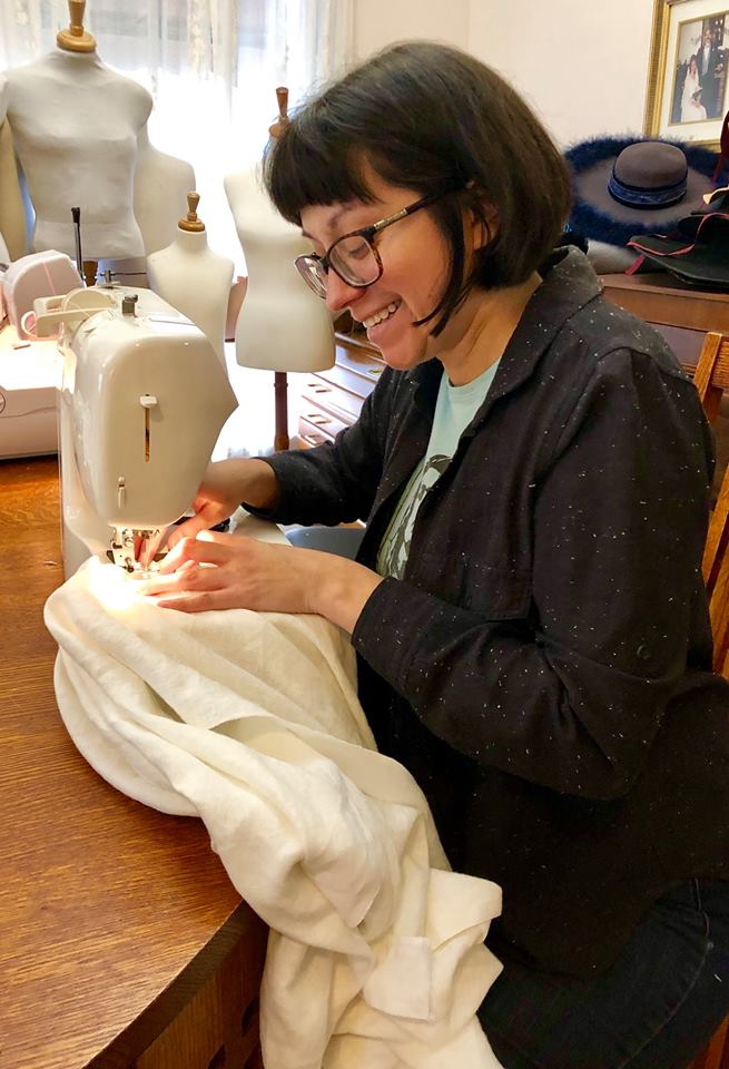 Kelli Bland sewing 17th century shirts.