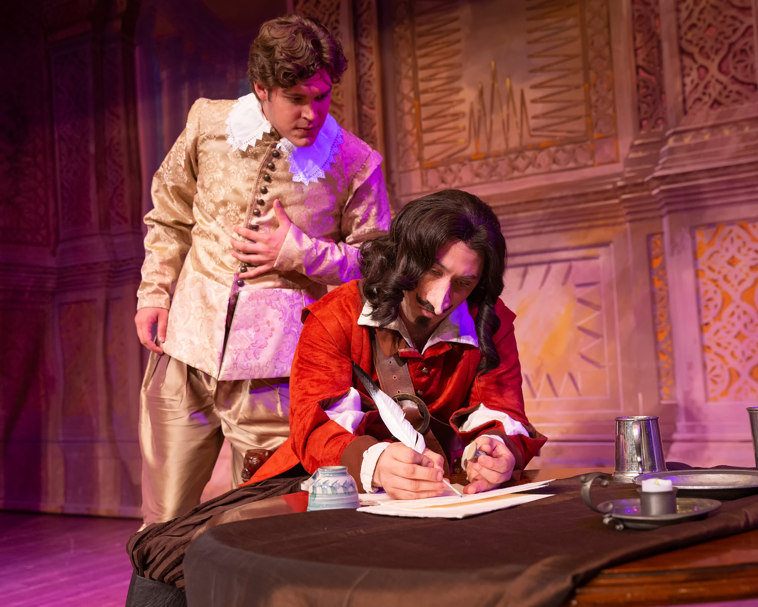 Cyrano lends his ready wit to help Christian write love letters to Roxane. The same letters he has written in his heart a thousand times before. Photo by Steve Rogers