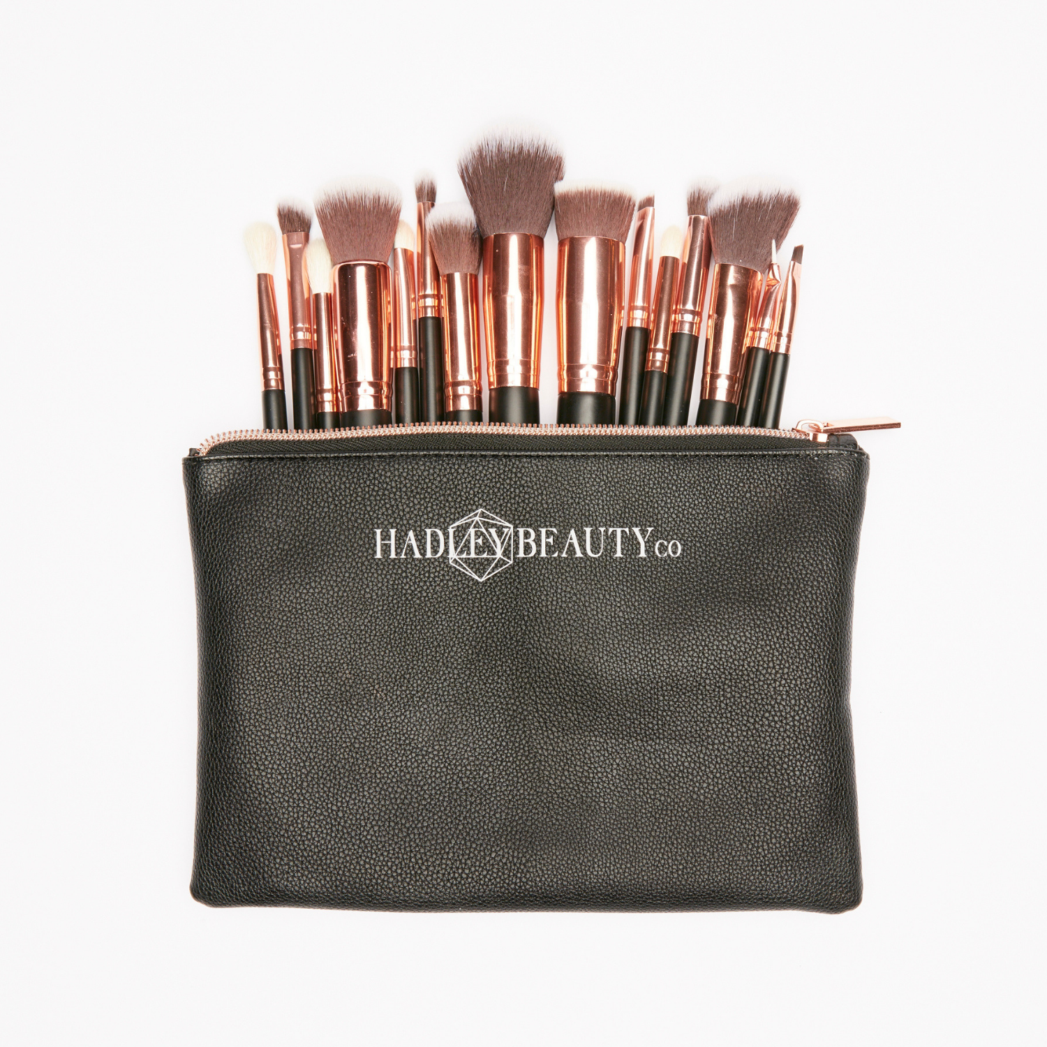 Hadley Beauty Co. - Hadley Beauty Co is the makeup brush brainchild from our GLAM Founder/Owner Meghan Hamilton. Named after her daughter, Hadley Beauty Company (or HBC) is a complete set of 15 makeup brushes - everything you would ever need to complete the perfect GLAM look! 11 of 15 are synthetic/vegan, and the remaining 4 are cruetly free natural brush hair. The goal is to make sure you each brush is multi functional, and perfect for the GLAMbeauty on the go!