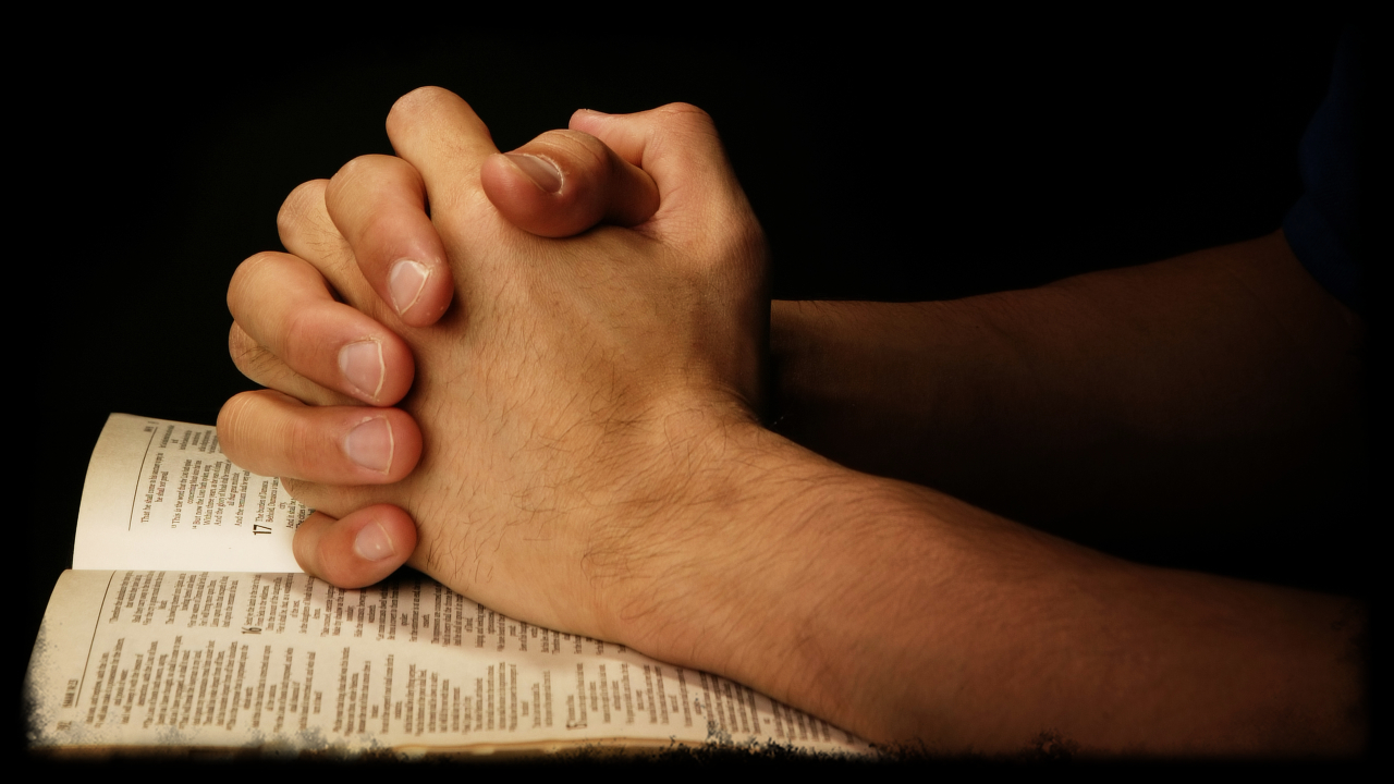 praying-hands-on-scripture.jpg