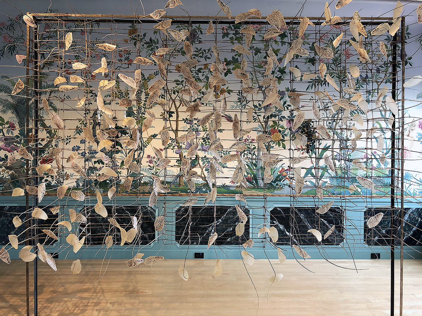 """THE LIMITS OF PARADISE  site-specific installation: Tree of Heaven Sumac stems, laser-cut woodblock print on brown line mylar, steel 8'h x 10'w x 4'd shown in the Zubar wallpaper room of the Villa Terrace Museum of Decorative Arts, """"Look Here"""" exhibition 2018"""