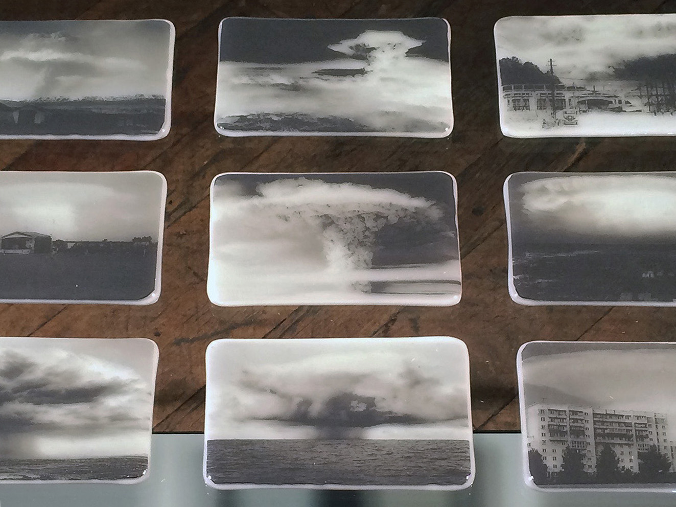 "CLOUD STUDIES II , 15 fused glass postcards each 4""x 6"" , glass and steel base 40""h x 40 1/2""w x 18 1/2""d 2016"