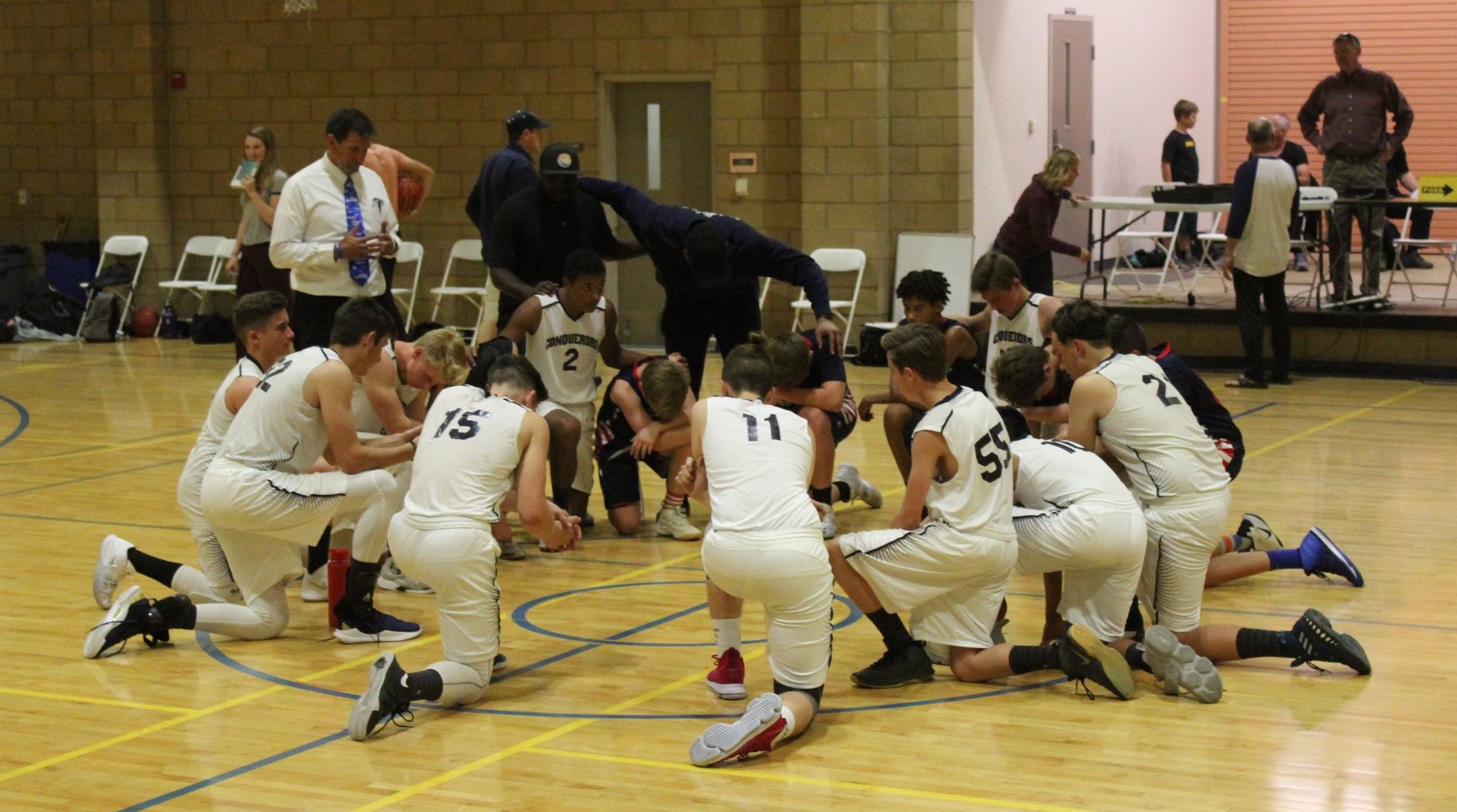 Basketball Team Huddles