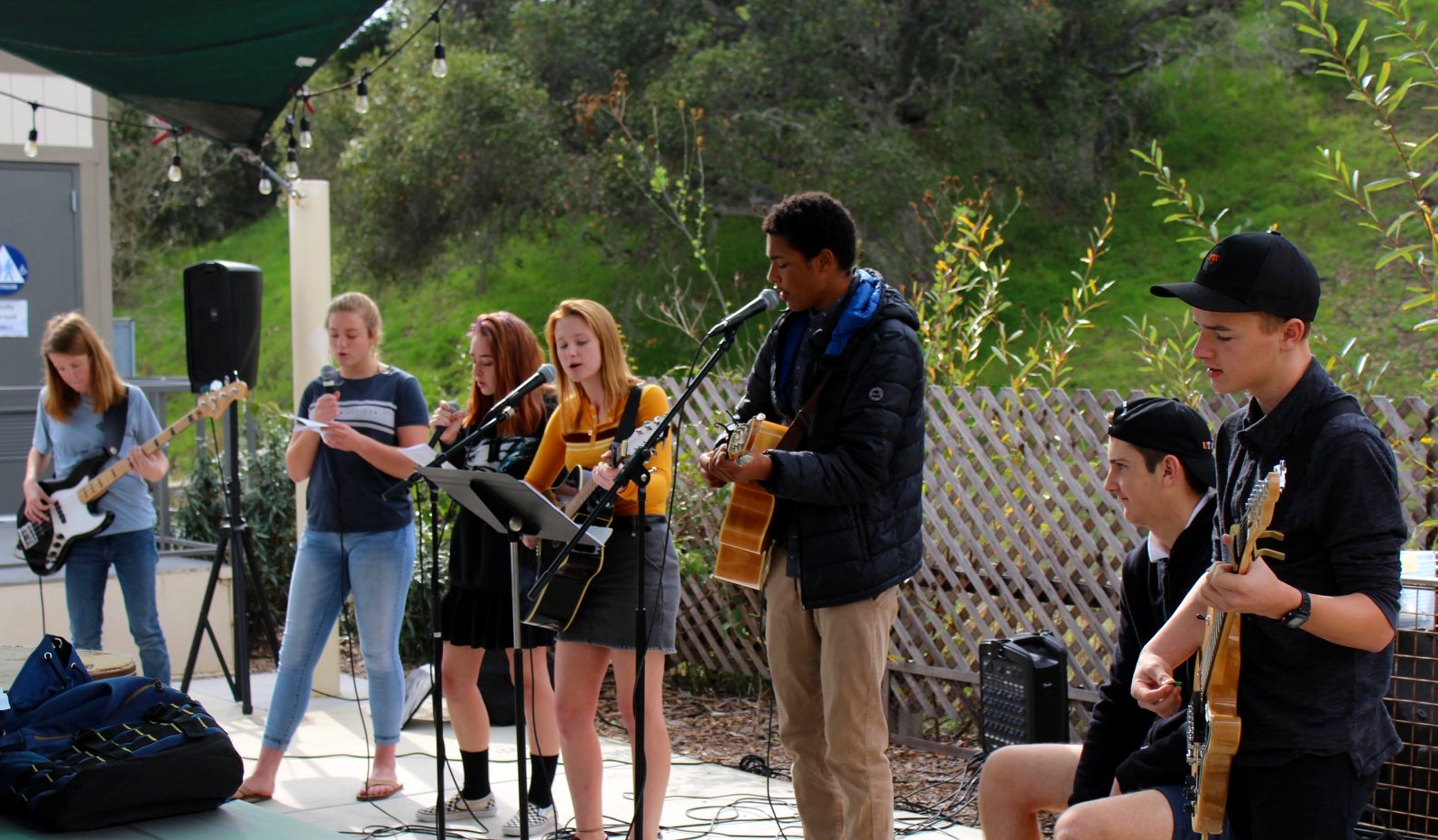 Students leading worship during chapel