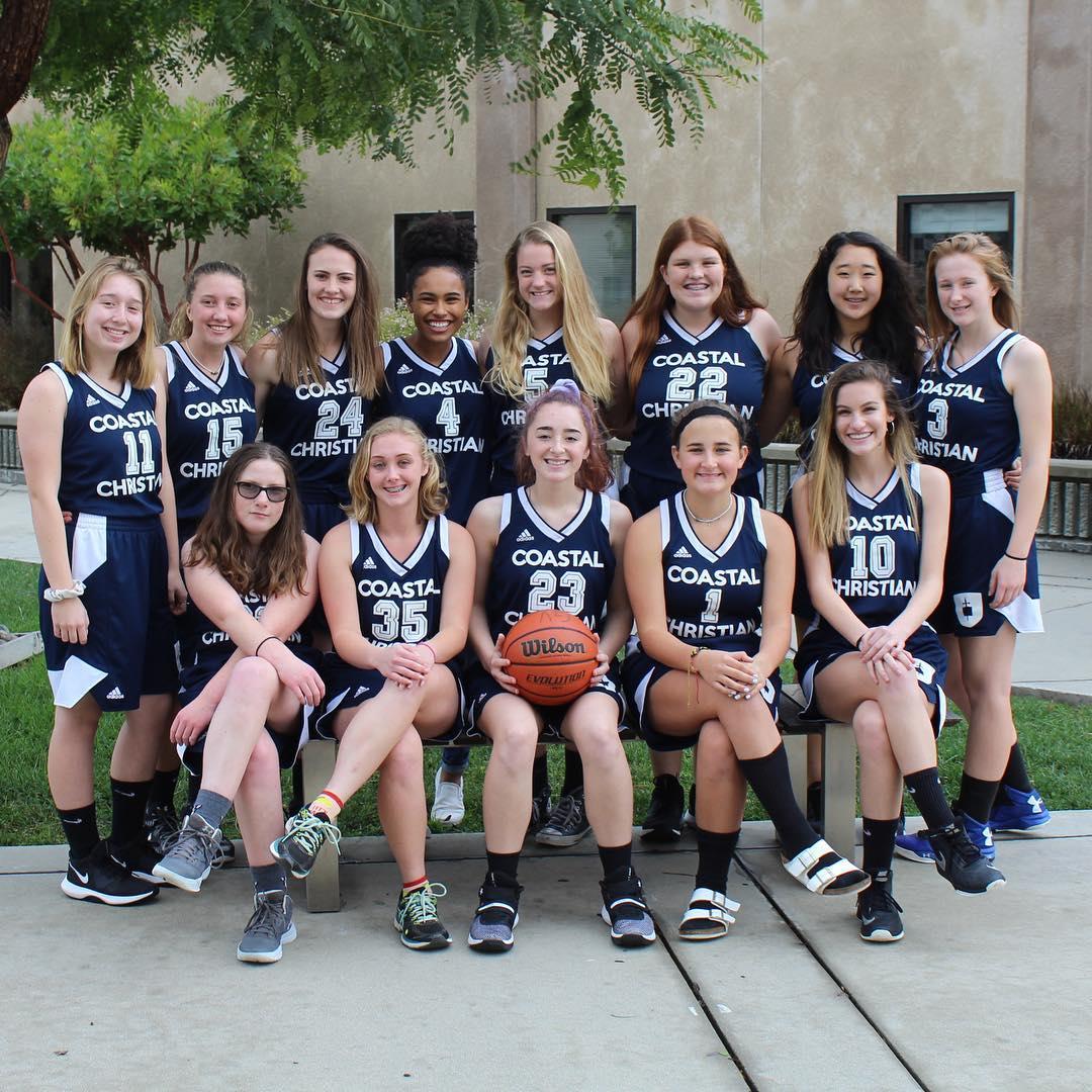 Girls basketball team poses for photo