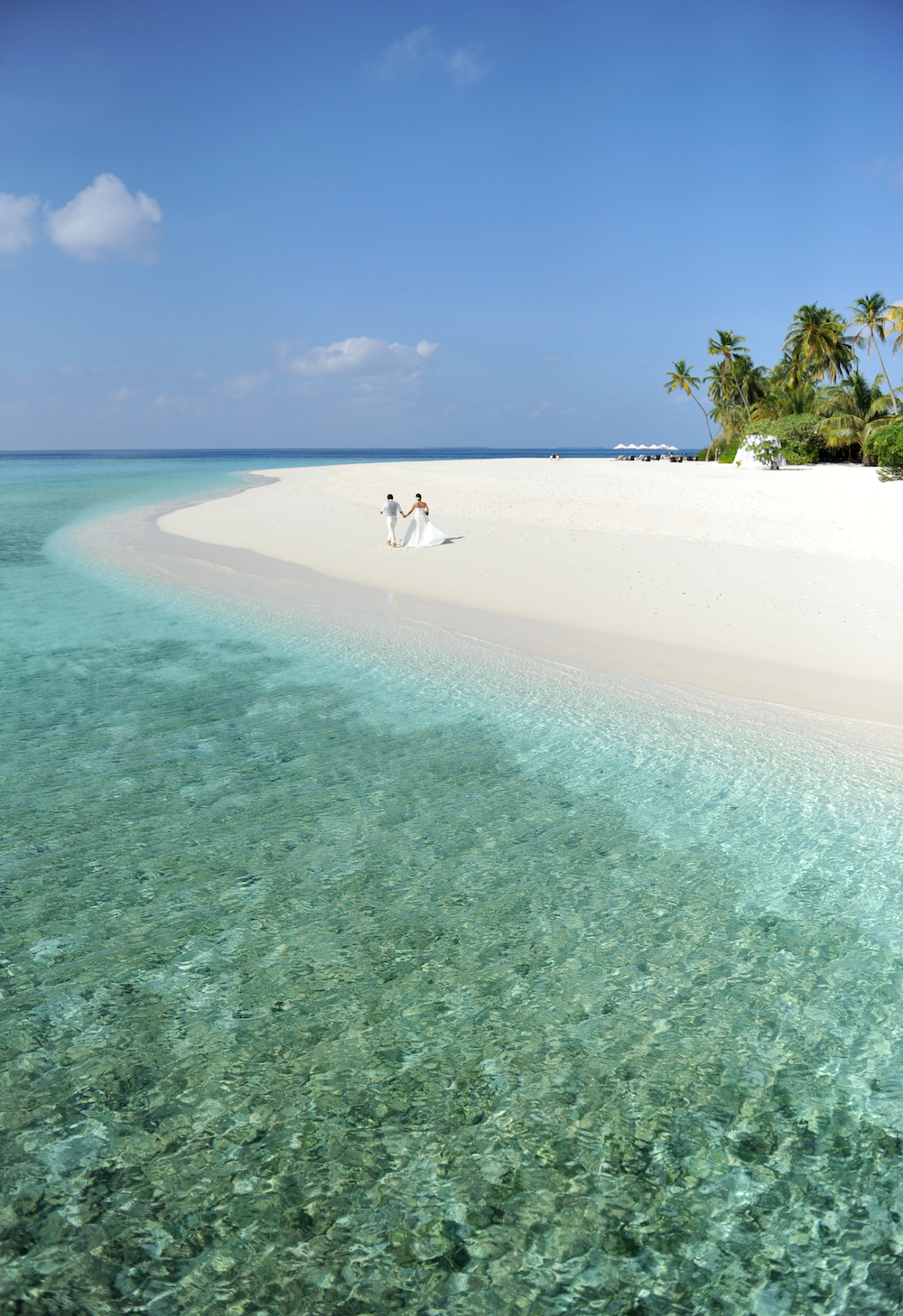 Honeymoon in Maldives - Couple walking on beach
