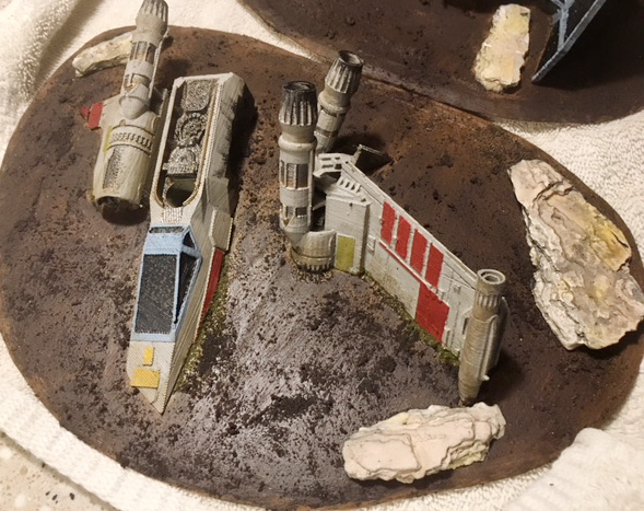 A closer look at the X-Wing on its base, with the sand and Stirland Battlemire mud texture present.