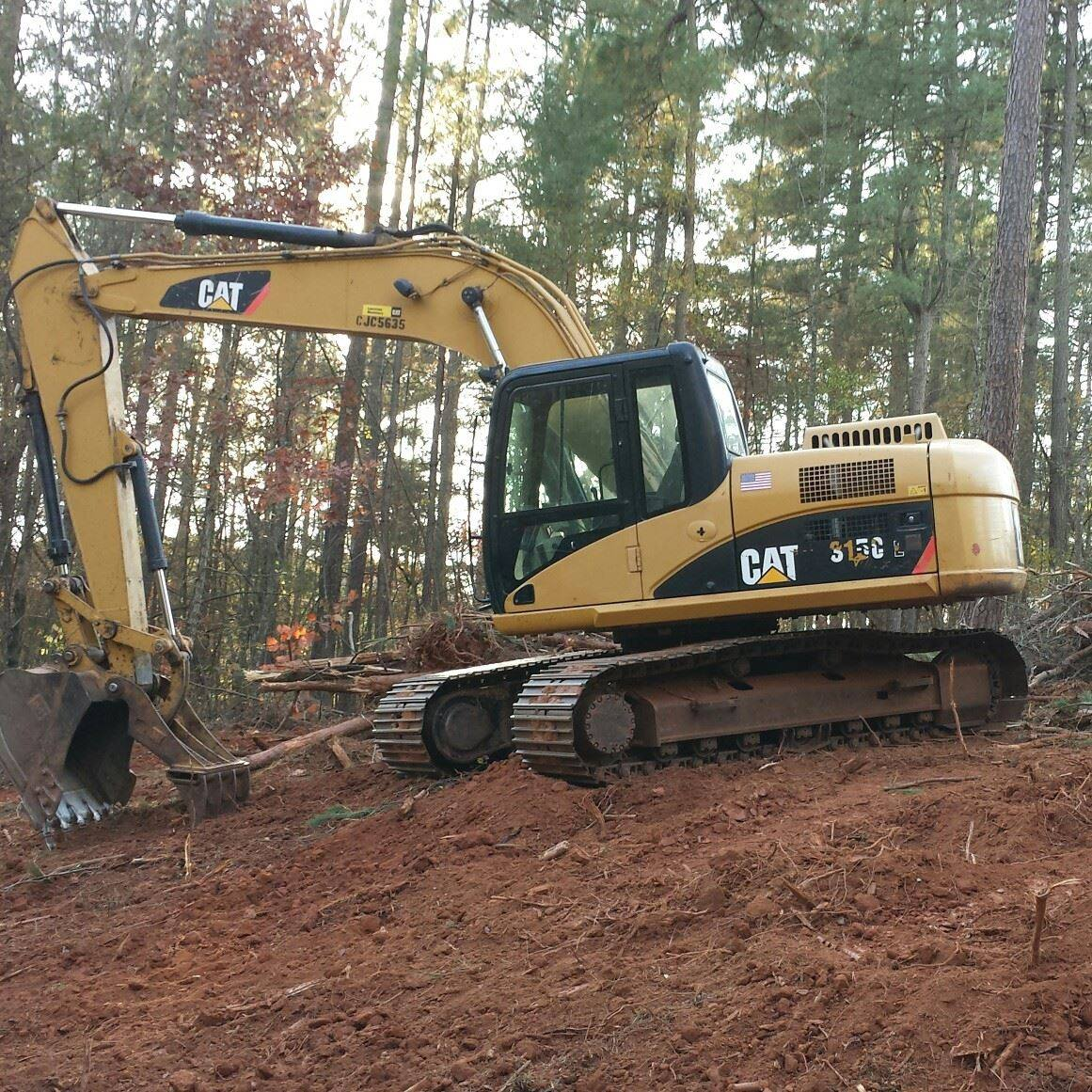 Left Hand Man - Caterpillar 351C specializing in demolition, excavating, and hauling.