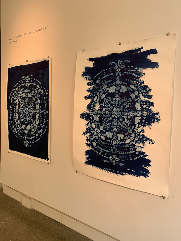 Two pieces from the Above Earth, Below Sky exhibit at the Quirk Gallery.