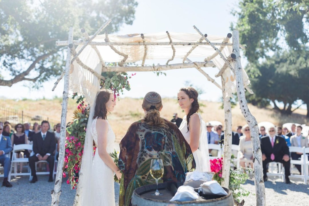 15-Central-Coast-House-of-Design-–-Yvonne-Baughman-–-Paso-Robles-LGBTQ-wedding-Central-Coast-LGBTQ-wedding-planner-Oyster-Ridge-Barn-Wedding-exchanging-vows-1080x720.jpg