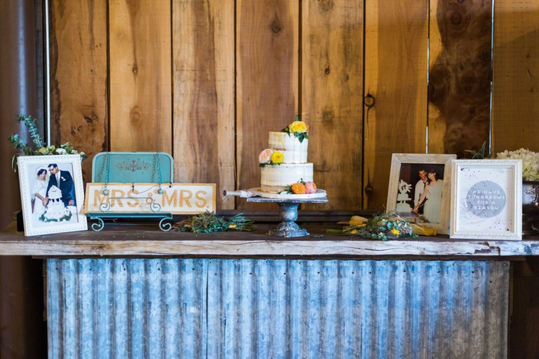 32-Central-Coast-House-of-Design-–-Yvonne-Baughman-–-Paso-Robles-LGBTQ-wedding-Central-Coast-LGBTQ-wedding-planner-Oyster-Ridge-Barn-Wedding-cake-table-1080x720.jpg