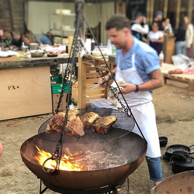 Chef Robin Gill @thedairyclapham in action at PX+ festival last weekend. Great fun working with @treewood.harvesting @kadaifirebowls @gamechangerbbq @julian_d_brown @skeppshultuk keeping the fires going. @pxplusfestival @dougychef  #pxplusfestival #kadaifirebowl #thedairyclapham #lambbbq #sustainablefirewood