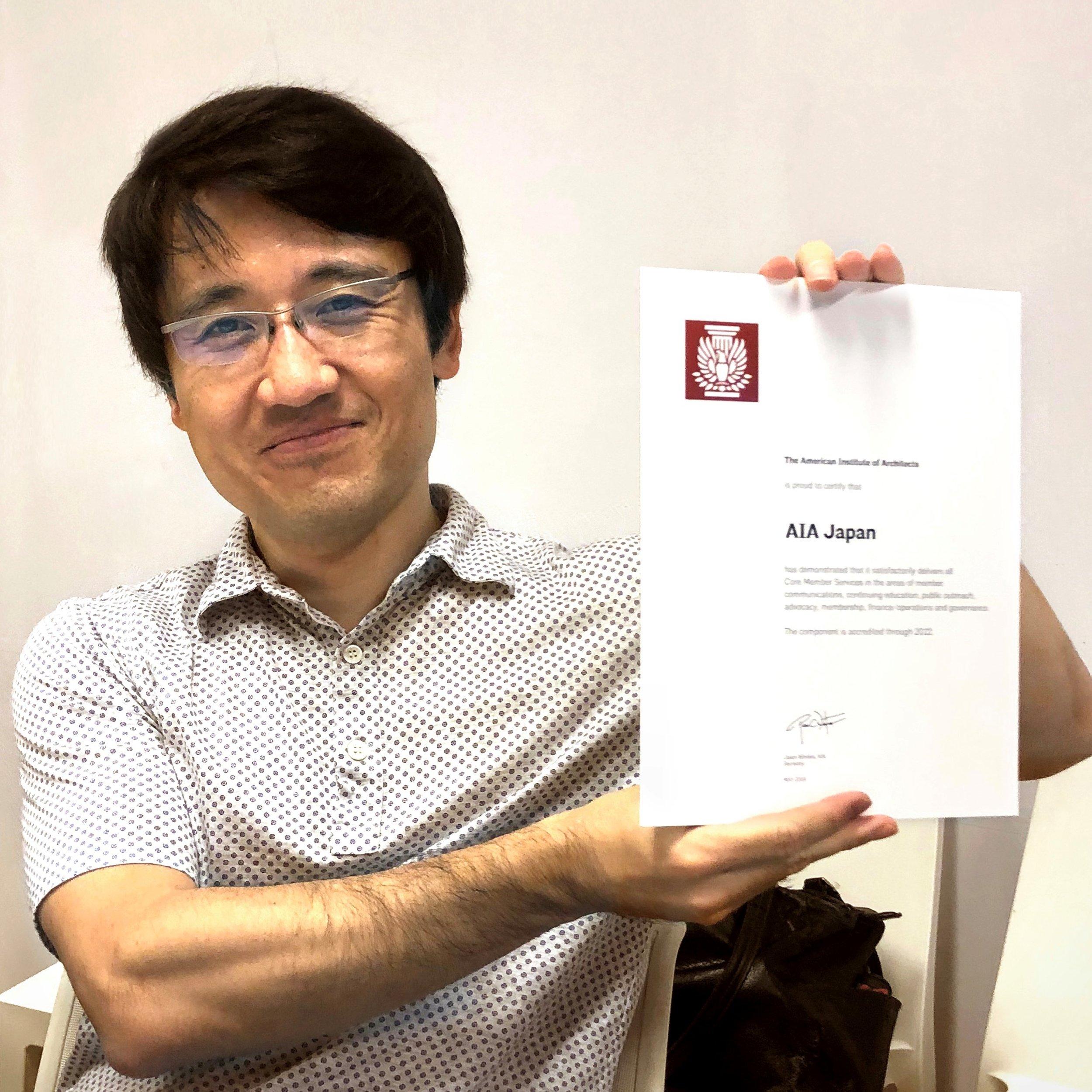 2018 AIA Japan President Daishi Yoshimoto holds the Accreditation Certificate.
