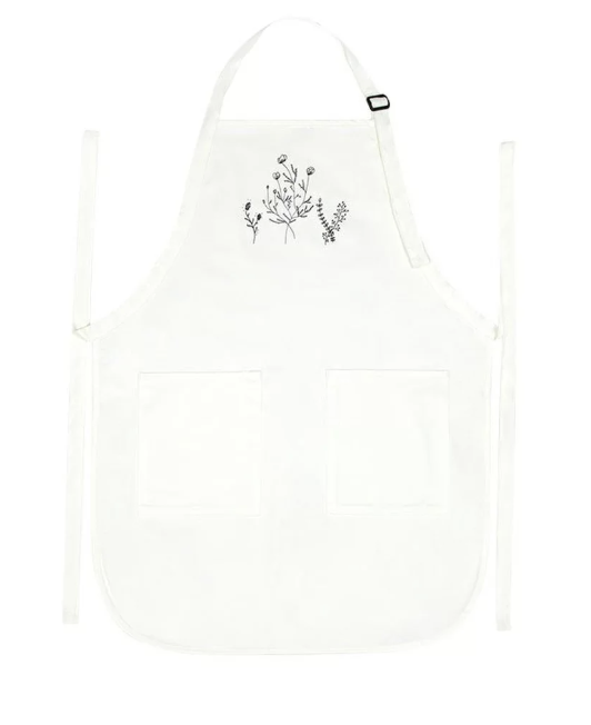 Flower Apron - Go ahead, go wild with with the powdered sugar!Material : 100% cotton twillWhat you'll get1 adult apron with two front pockets100% cotton twill with soil-release finishAdjustable neck strapMeasures 22