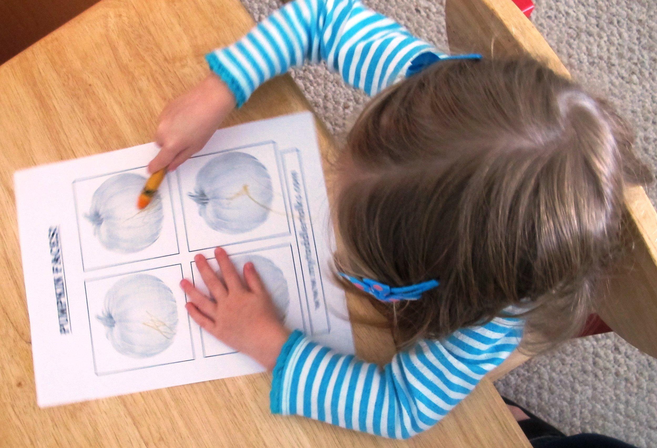 kerri coloring her pumpkins