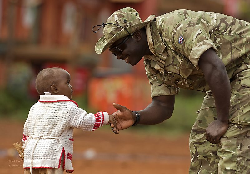 A Soldier is Welcomed to Kenya by a Young Child