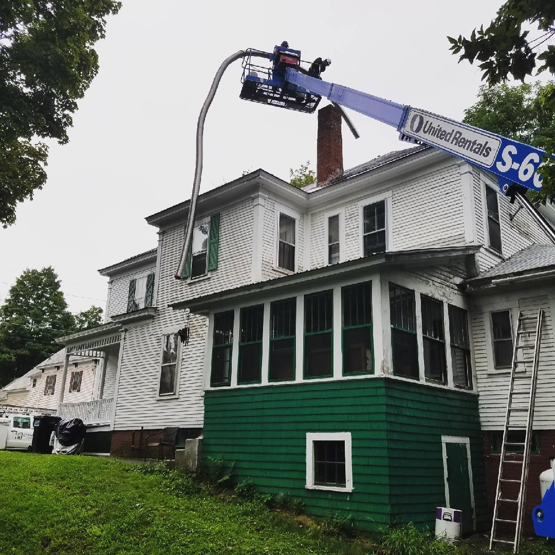 Chimney Savers donated time and materials to repair two chimneys on this Claremont, NH, home in September, 2018.