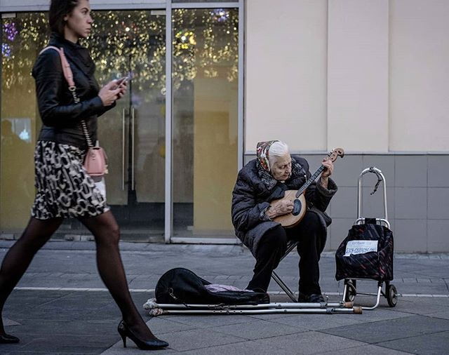 Everyday in Russia - Babuchka playing the domra on Nikolskaya Street . . .  #bealpha #moscow #streetphotography #SPicollective #storyofthestreet #streetscenesmag #friendsinperson #photocinematica #magnumphotos #cinematography #challengerstreets #intercollective #ourstreets #fromstreetswithlove #everybodystreet #streetclassics #streetlife_award #life_is_street #myspc #lensculture #streetphotographerscommunity #travelingthroughtheworld #sonyalpha #Moscou #Russie #москва  #фотографуфа #assignment
