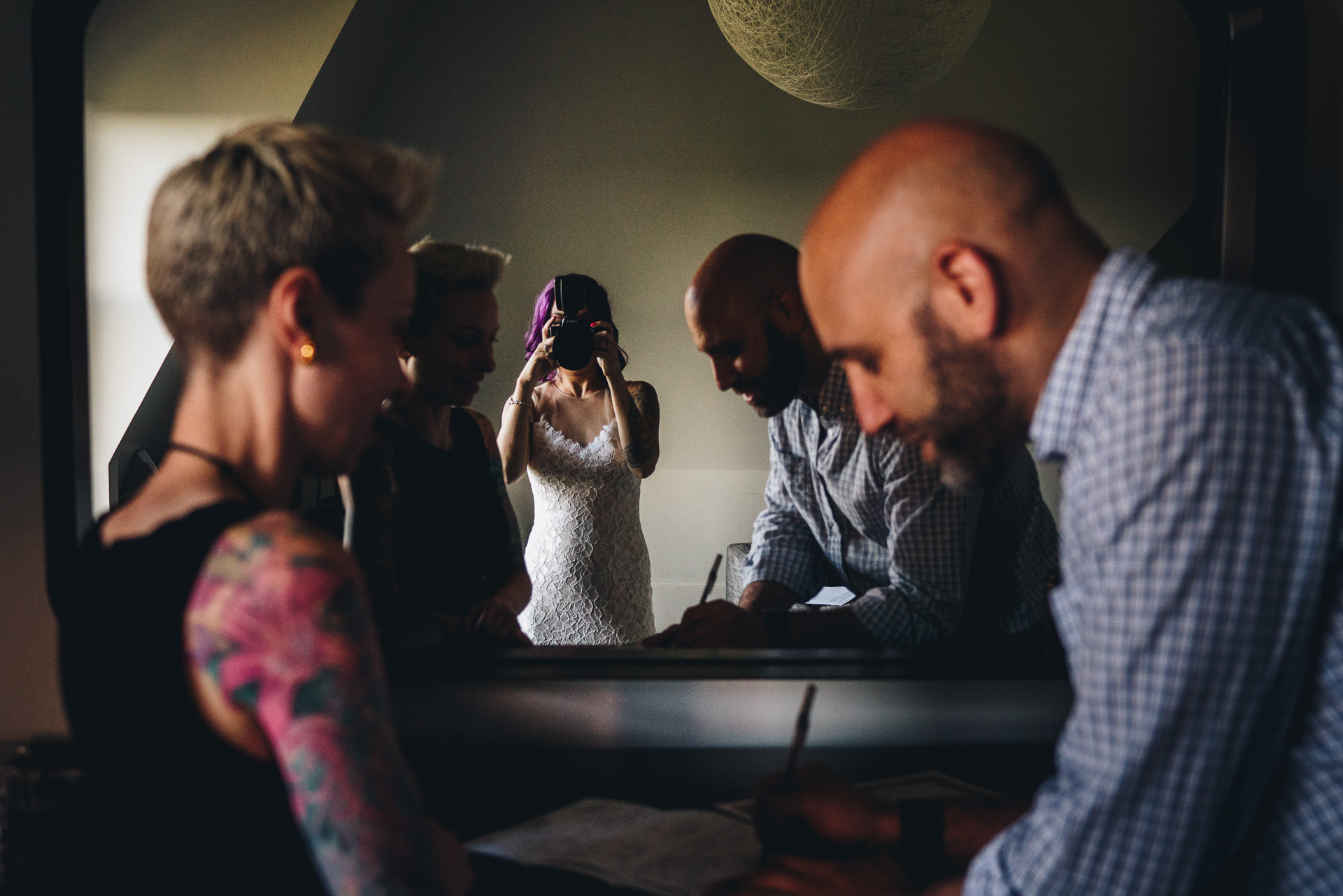 The photo we used as episode art is from Andy Buscemi. He's actually the guy signing the marriage license in the photo (as the witness). His bride picked up his camera after he set it down and took a photo of him (and we love that story).