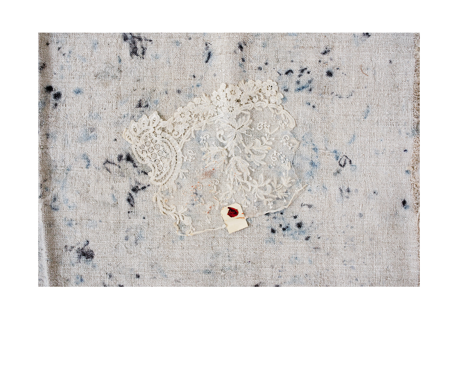 - Brussels Tape Lace style, c. late 19th - early 20th c., with delicate scrolling floral work, handmade. Fragment includes original wax seal tag.