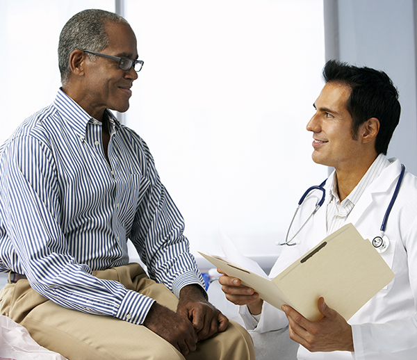 Doctor In Surgery With Male Patient Reading Notes - for web.jpg