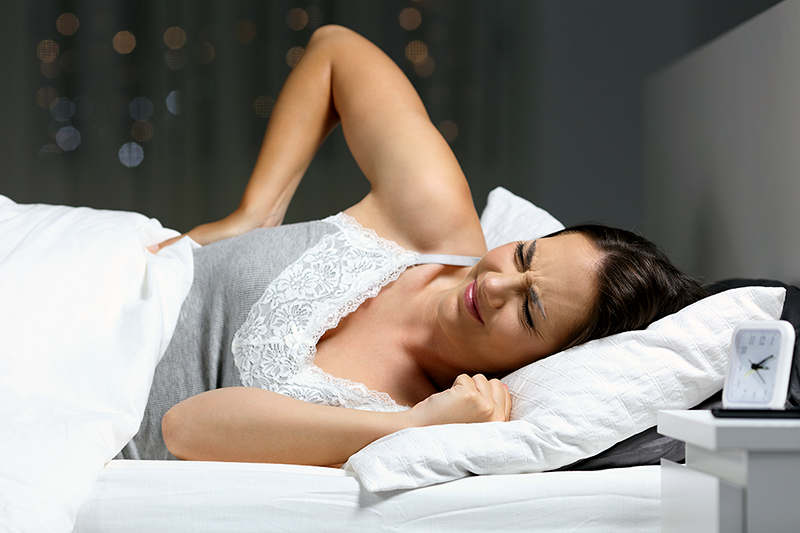 woman in bed with painsomnia.jpg