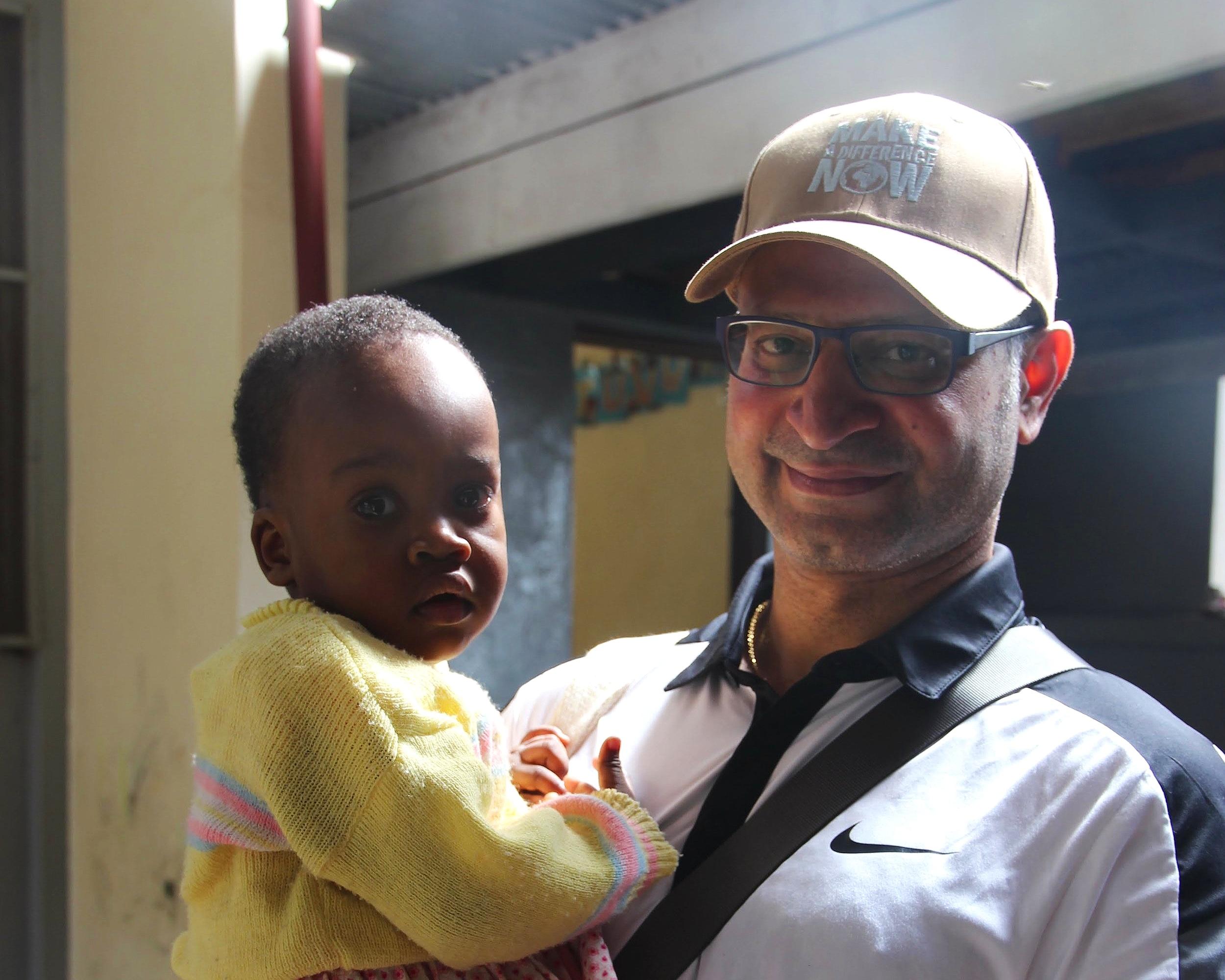 volunteer-holding-baby.JPG