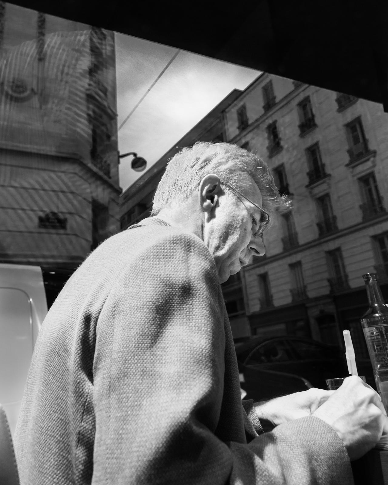 Working at a sidewalk cafe, Paris, 2013